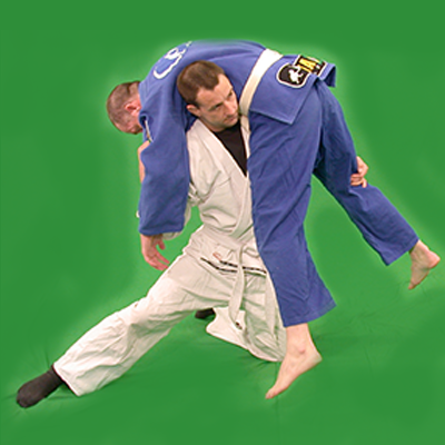 Ashley Phillips Sifu performing a grappling takedown