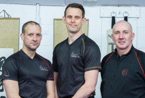 Russell Webster with Sifu Ashley Phillips (L) and Sifu Gary Cooper (R)